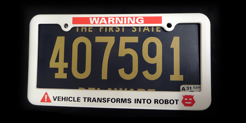 WARNING vehicle transforms into robot license plate holder